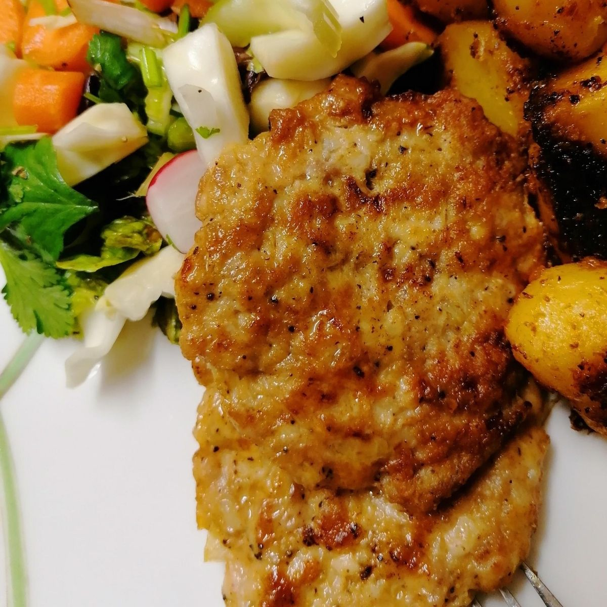 Chicken kebab patties with potatoes and salad