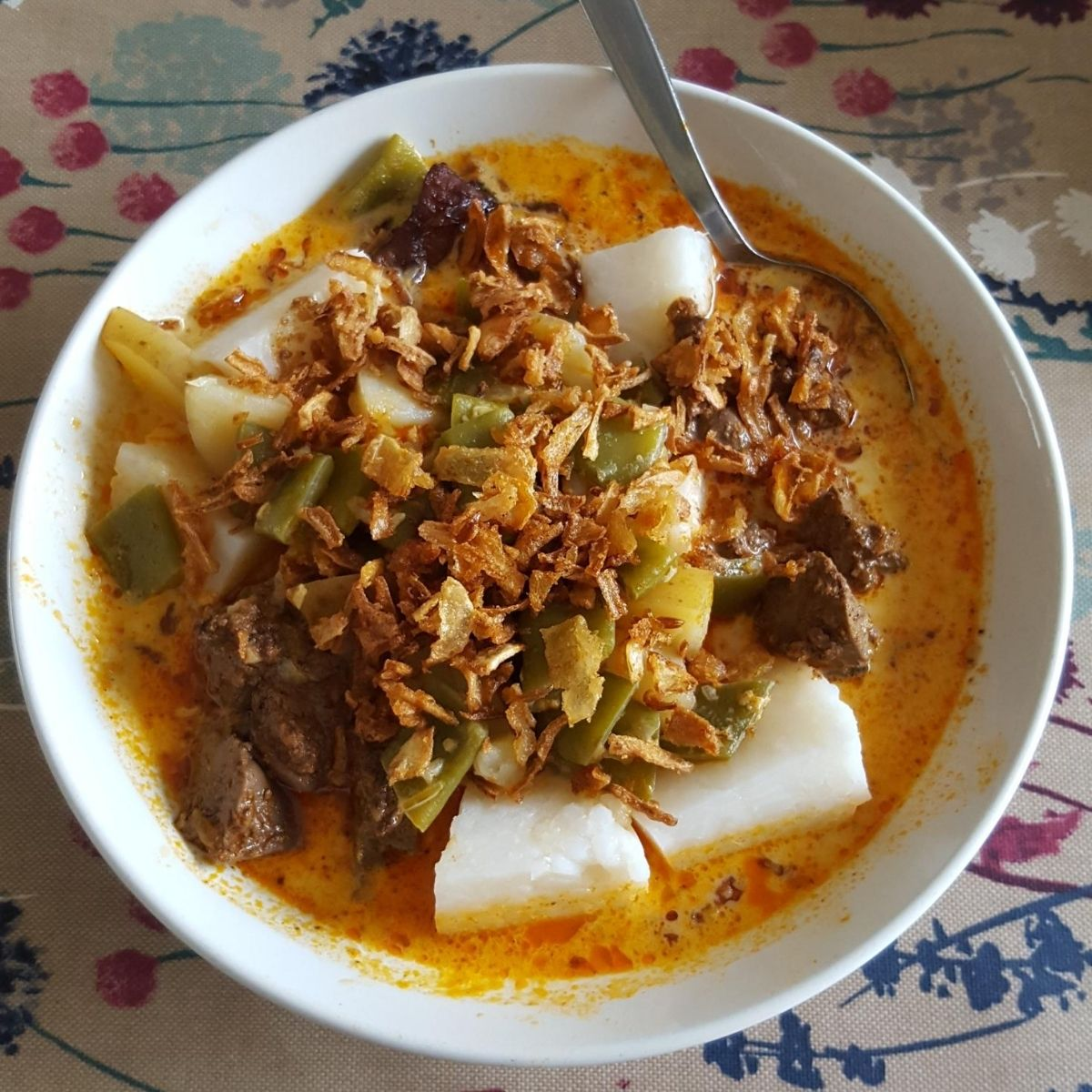 Lontong sayur - Indonesian vegetable curry with hard-boiled rice cake called lontong