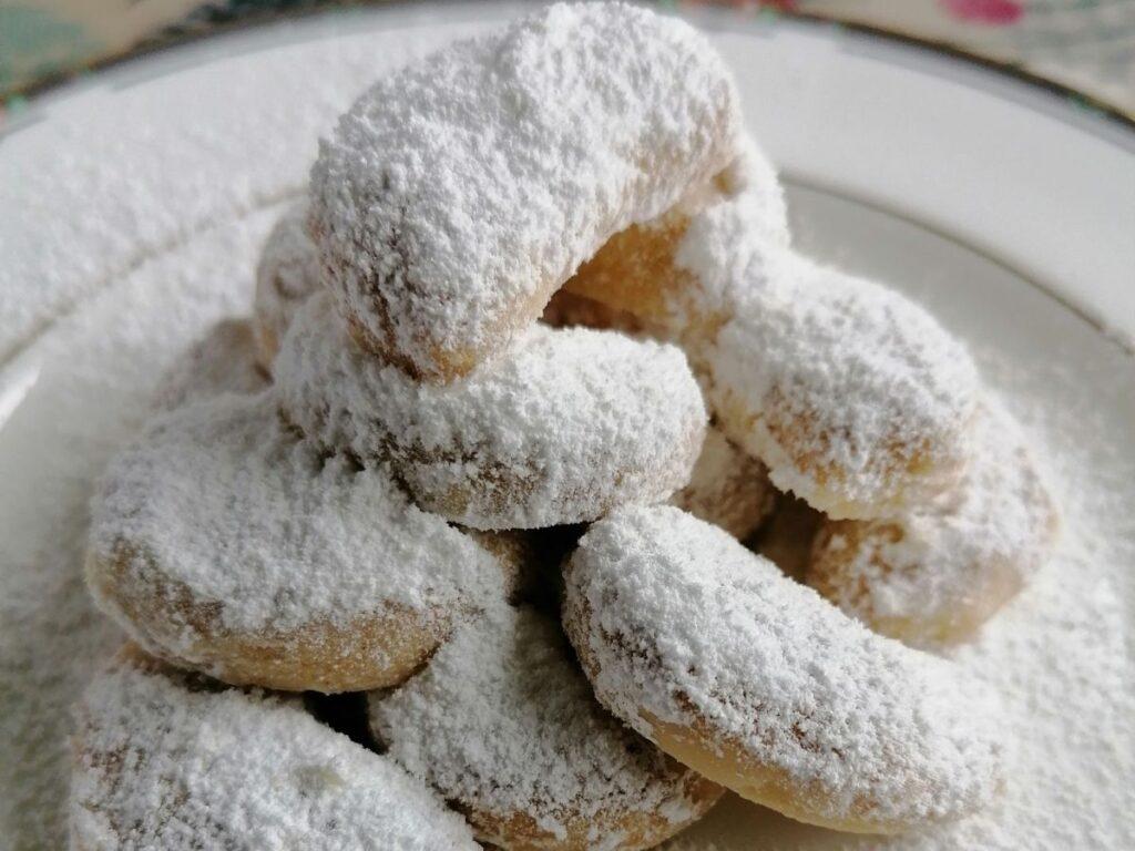ready baked kue putri salju coated with icing sugar