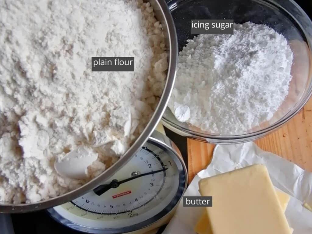 three ingredients to make kue putri salju - snow white butter cookies
