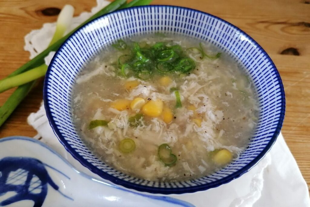 A bowl of Indonesian chicken and sweet corn soup