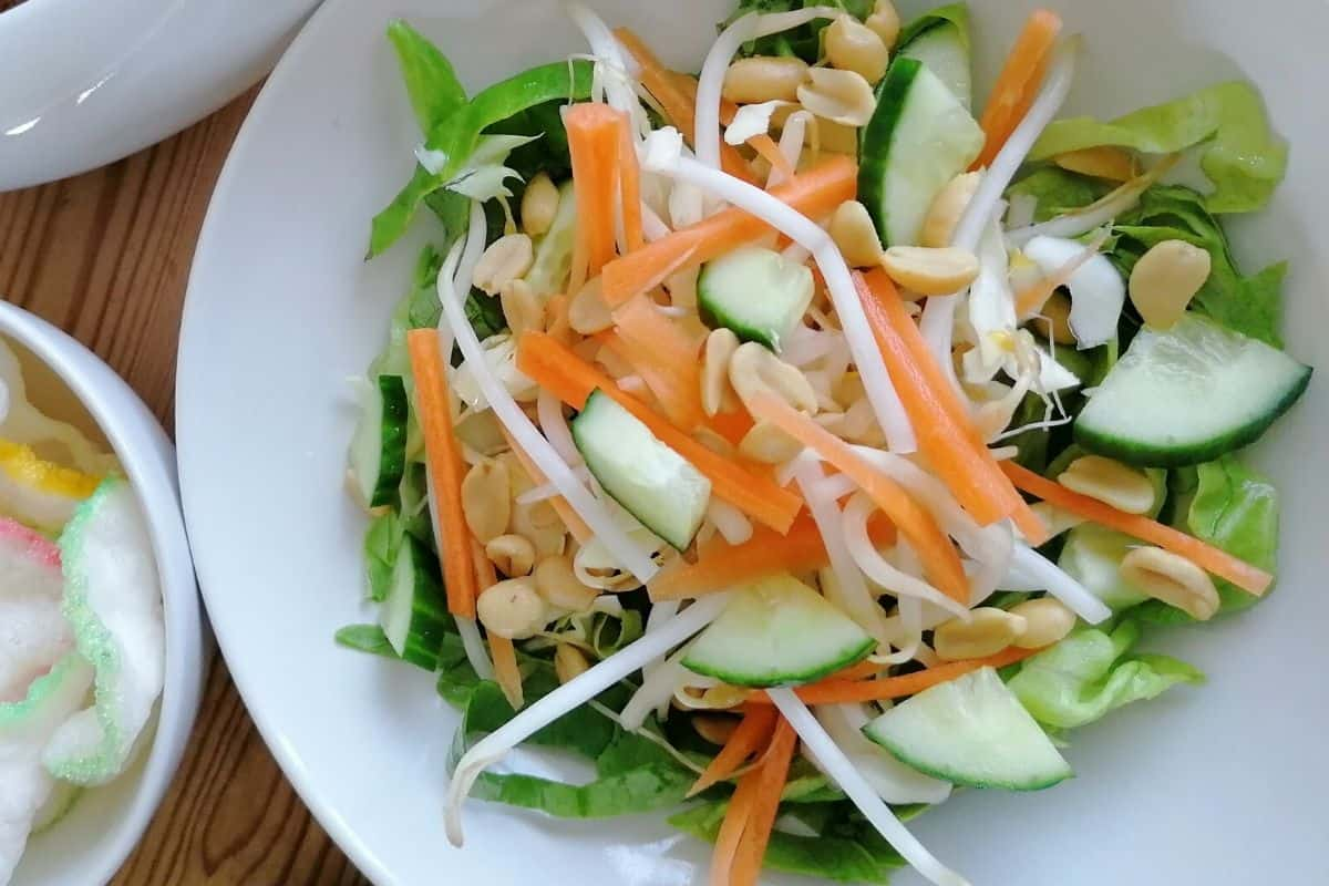 a bowl of carrot, cucumber and beansprouts salad