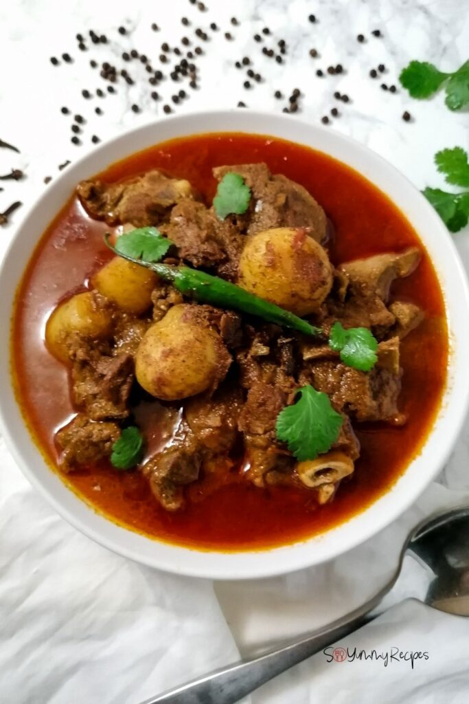 A bowl of Pakistani lamb meat curry with potatoes called Aloo Gosht
