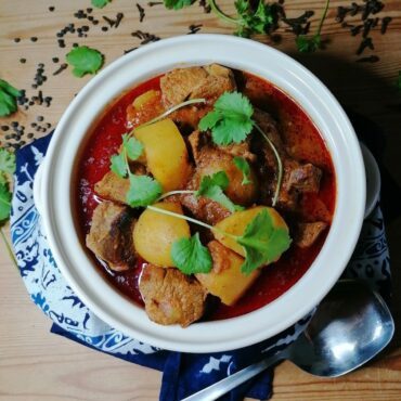 Pakistani aloo gosht - meat and potato curry