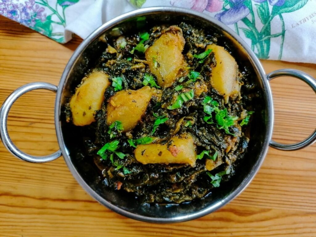 Pakistani aloo palak - potato and spinach curry