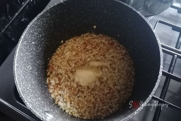 onion and ginger garlic paste frying in a pan