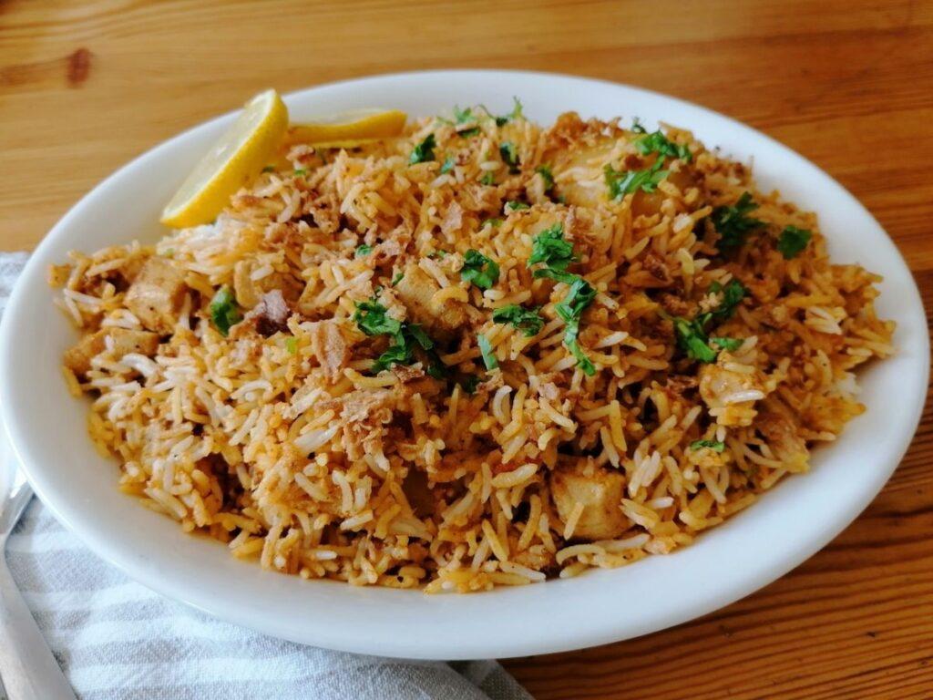 chicken biryani rice in an oval dish
