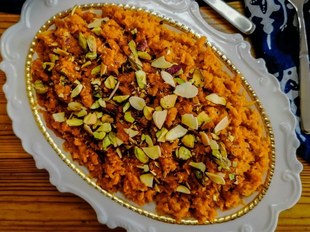 carrot halwa in a white oval dish