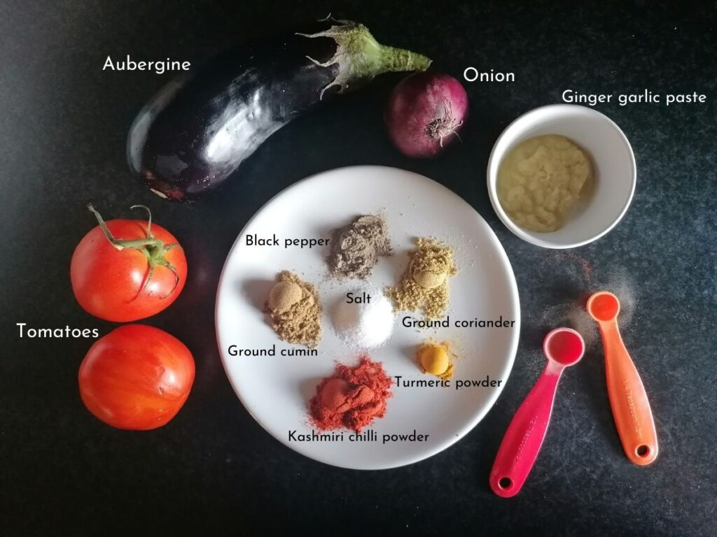 Tomatoes, aubergine, onion, and some spices to make aubergine curry