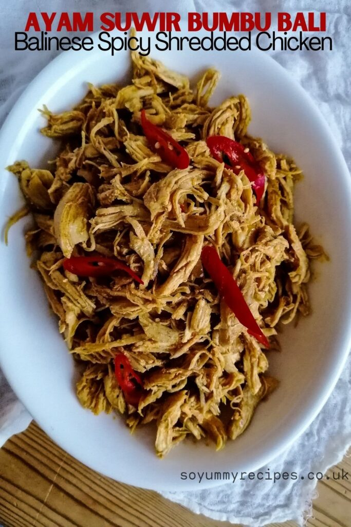 an oval dish of ayam suwir bumbu bali - the shredded chicken in Balinese spices with overlay texts