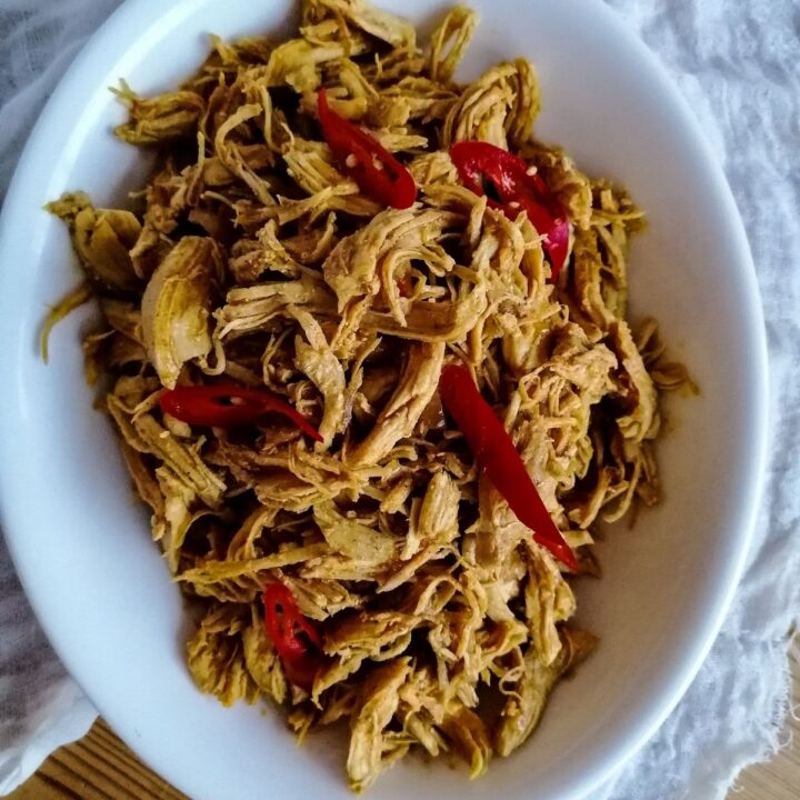 Ayam Suwir Bumbu Bali - shredded chicken with Balinese spices in an oval white dish