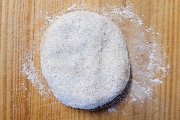 Flattened roti dough