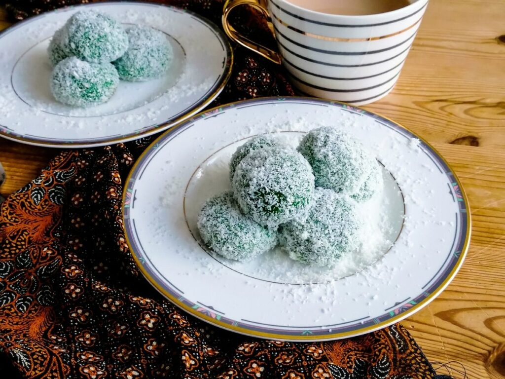 two plates of klepon - Indonesian glutinous rice balls
