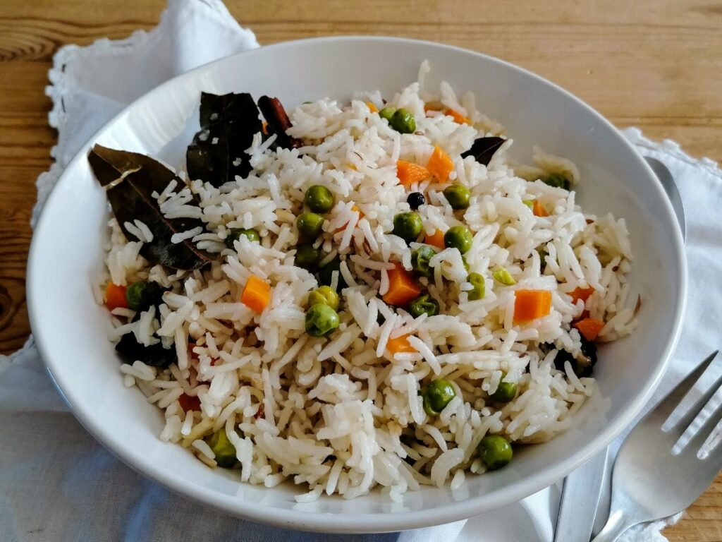 Vegetable pilau rice in a white bowl