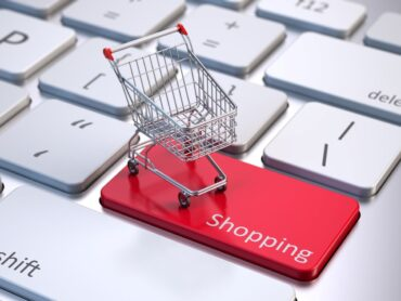 a shopping trolley on a laptop keyboard