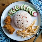 Nasi Uduk Jakarta with fried chicken, cucumber and omelette slices