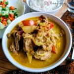 a bowl of lamb tongseng - javanese braised lamb in spice coconut milk