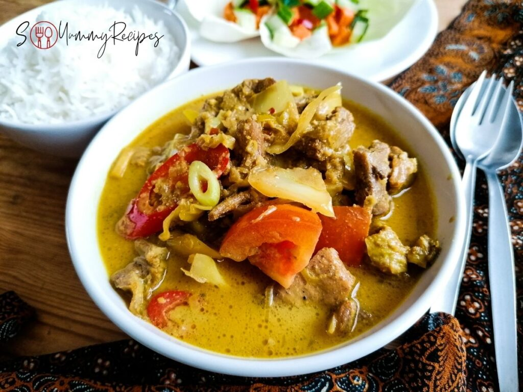 a bowl of Indonesian braised lamb in coconut milk