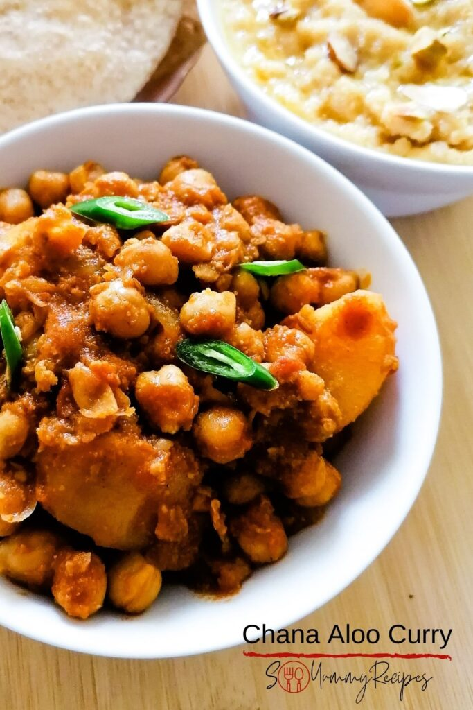 a bowl of chana aloo curry with overlay text