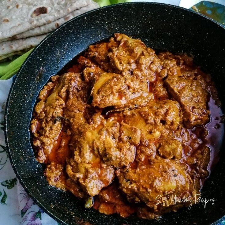 Achari chicken in cooking pan