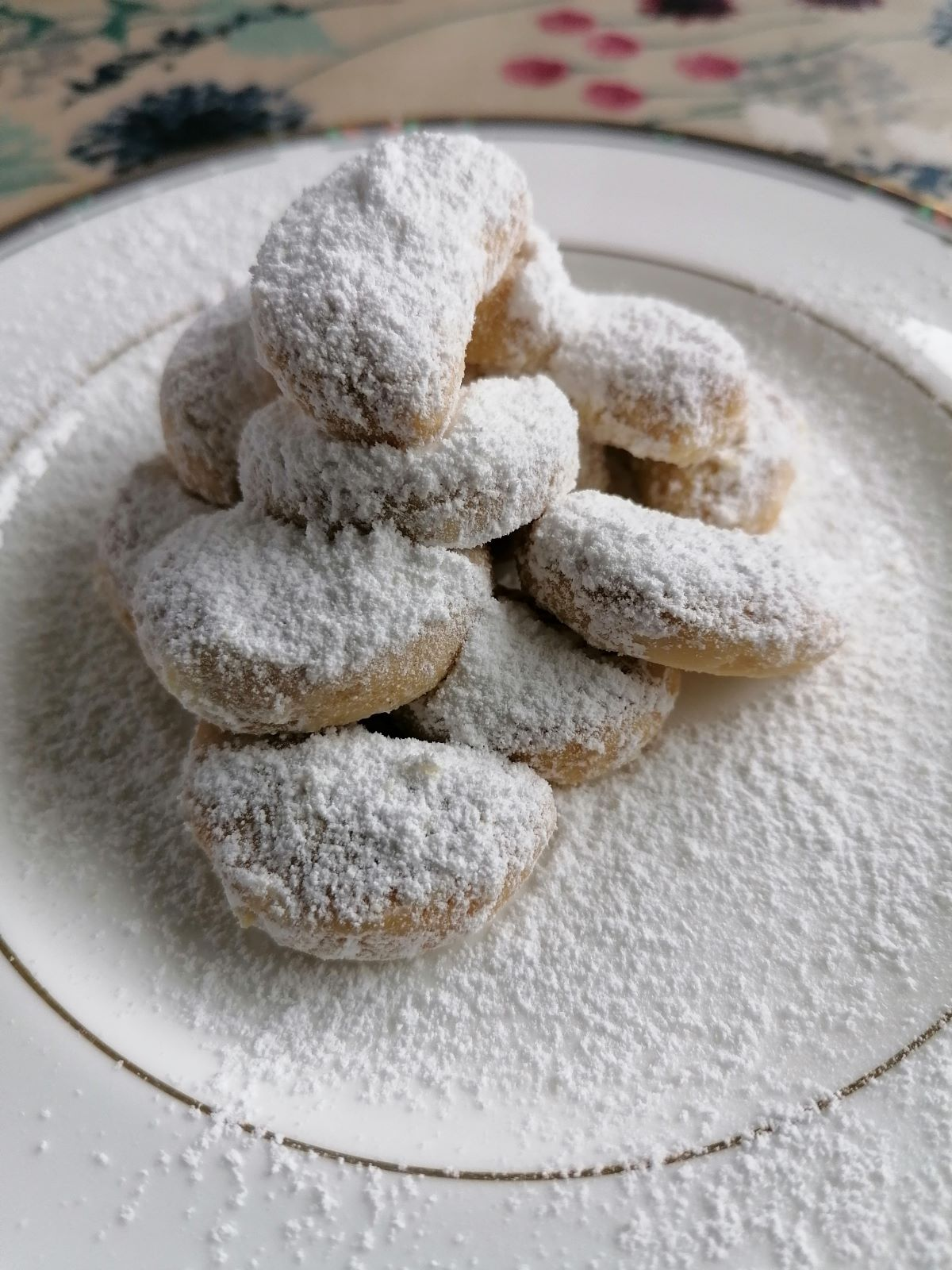 a stack of Snow White Butter cookies - the Indonesian Kue Putri Salju on a white plate