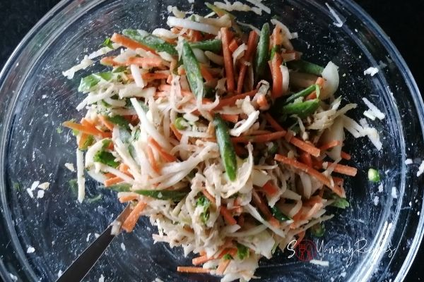 a mix of sliced and grated vegetables