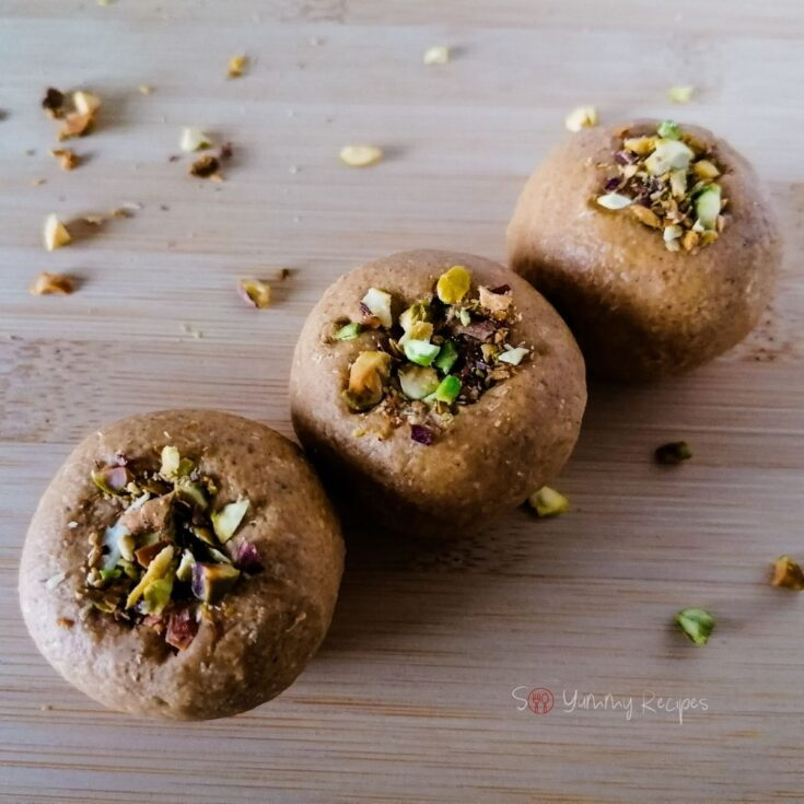 Besan Ladoo - the sweet treat balls made of chickpea flours with chopped nuts as the garnish