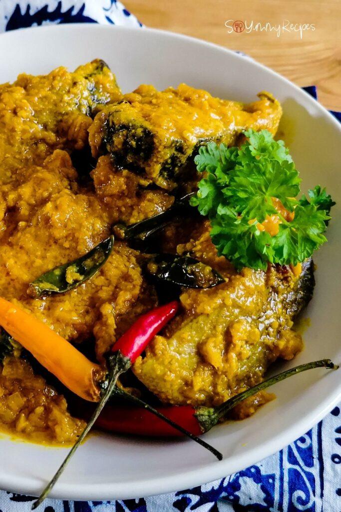 Yellow pickle fish - Ikan Pesmol - on a white bowl