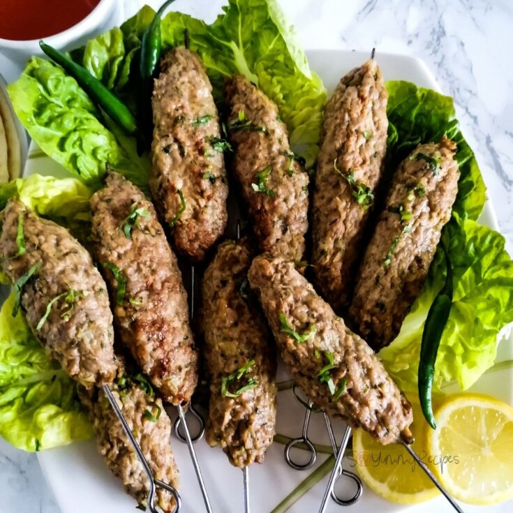 Chicken Seekh Kabab with lettuces and lemon slices