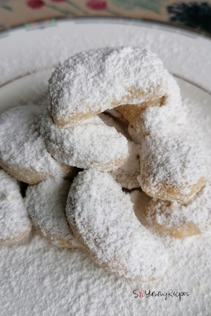 A pile of Indonesian Kue Putri Salju - the Snow White Butter Cookies - on a white plate