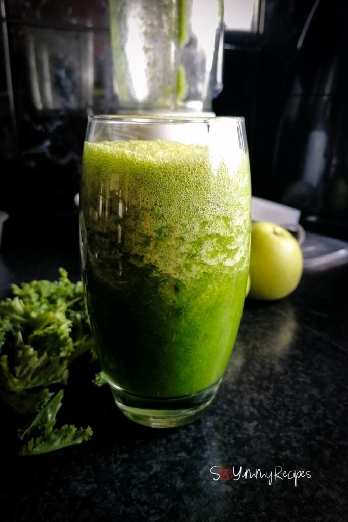 a tall glass of apple and kale smoothie