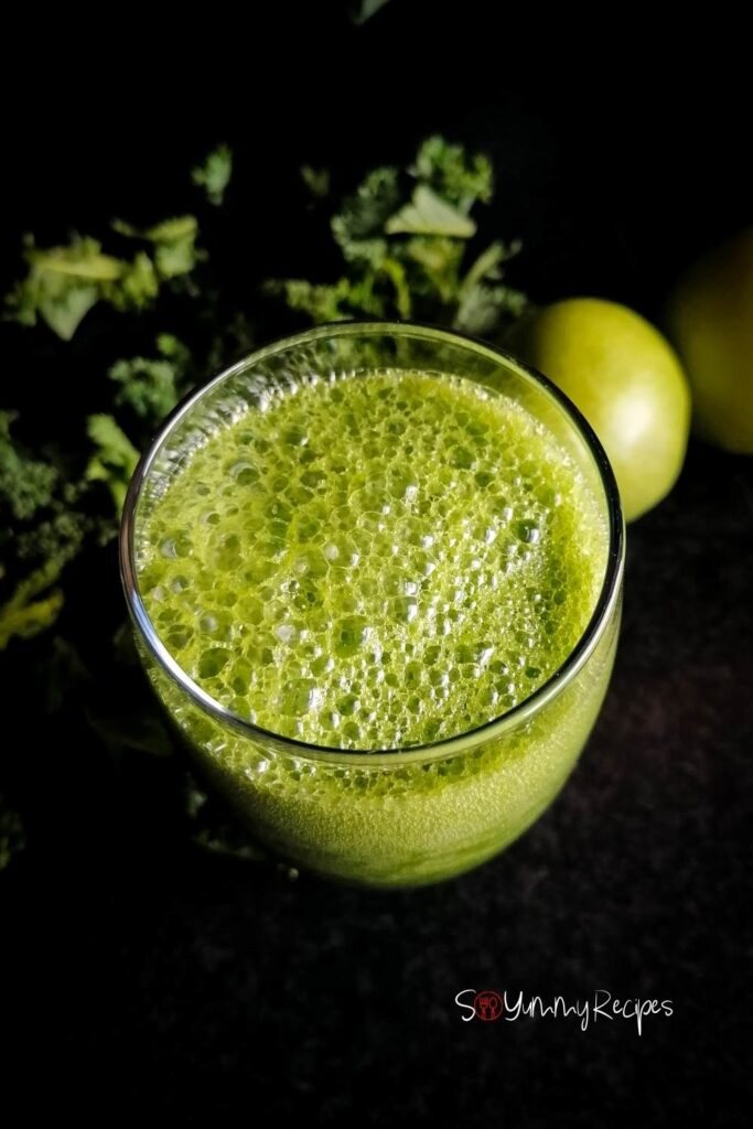 over the top of a glass of green smoothie