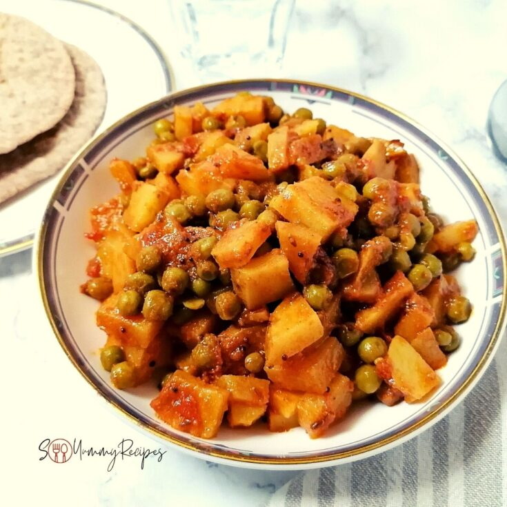 Pakistani Aloo Matar - the potato and green peas curry in a round dish