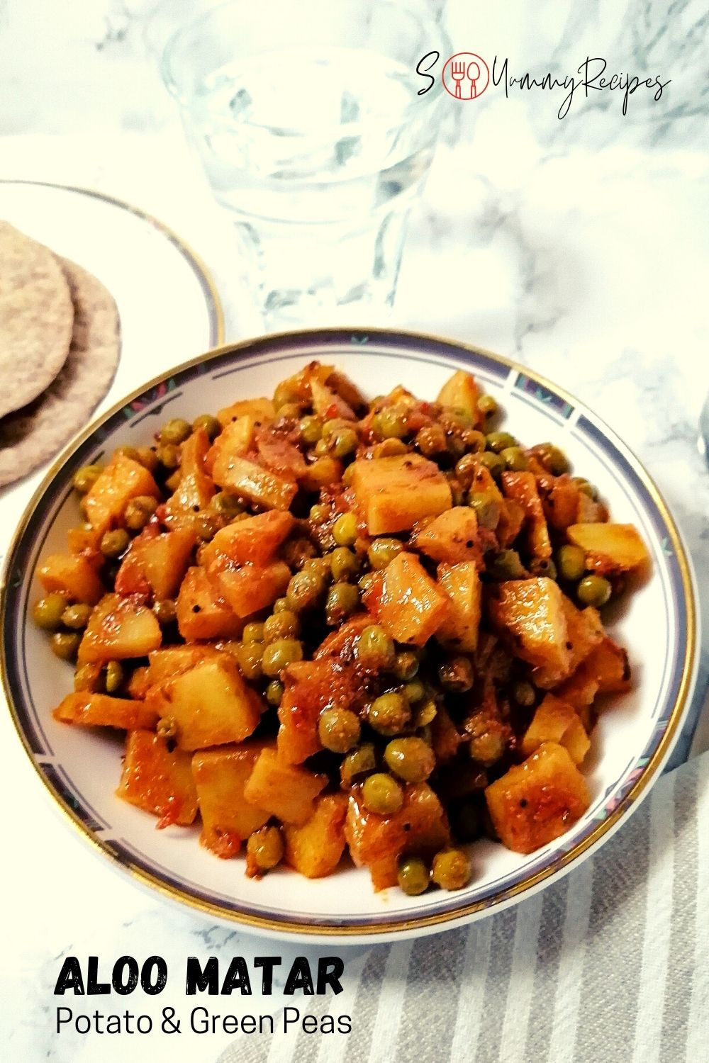 a round dish of Aloo Matar - the Pakistani potato and green peas dry curry
