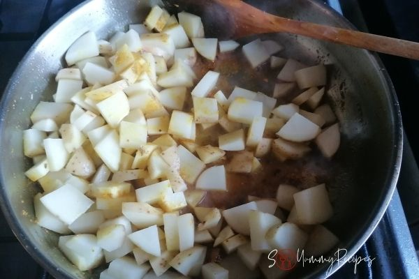 cooking the potatoes with spices