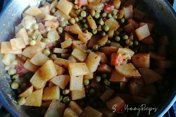 Aloo Matar is readily cooked in a pan