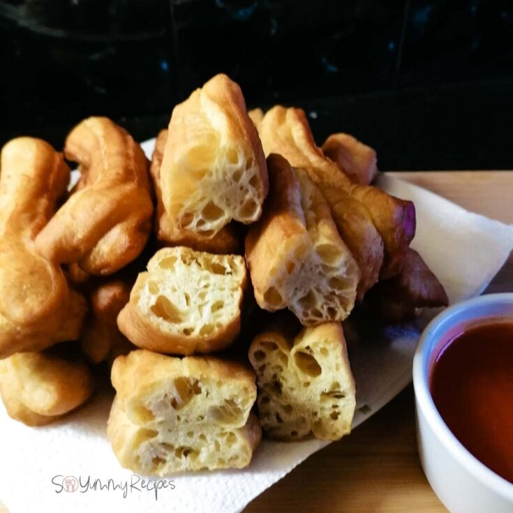a stack of Cakwe - the Indonesian fried dough sticks.