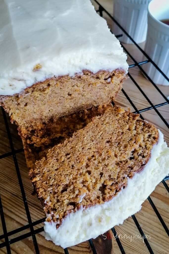 Carrot cake loaf that has been cut into a slice