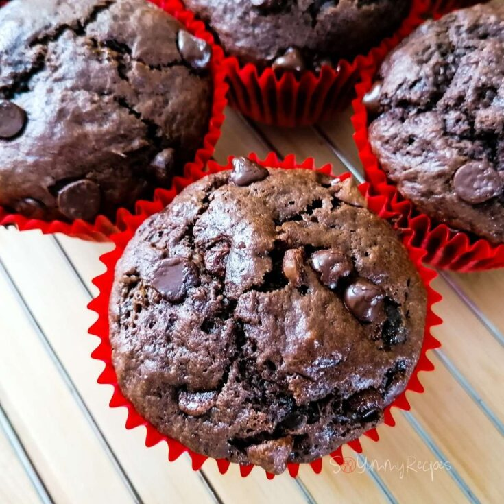 Double chocolate chip muffins in red paper muffin cases.